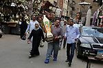 """An Egyptian man carries a traditional Lantern known as """"Fanous"""" in Arabic at a market ahead of the Muslim holy month of Ramadan in Cairo, Egypt, on May 21, 2017. Photo by Amr Sayed"""