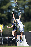 DURHAM, NC - FEBRUARY 26: Notre Dame's Casey Pearsall (24) and Duke's Olivia Jenner (right) challenge for a draw. The Duke University Blue Devils hosted the University of Notre Dame Fighting Irish on February, 26, 2017, at Koskinen Stadium in Durham, NC in a Division I College Women's Lacrosse match. Notre Dame won the game 12-11.