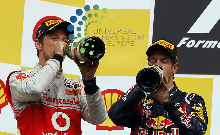 Formel 1 2011,11.Lauf Spa-Francorchamps,26.08.-28.08.11 .Jenson Button (GBR#4) Vodafone McLaren Mercedes, Sebastian Vettel (GER#1) Red Bull Racing..Picture:Hasan Bratic/Universal News And Sport (Europe) 28/08/2011.