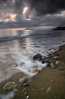 Ominous skies at sea off the beach of the small village of Varigotti in Liguria, Italy. Taken on a windy evening of early november, about 1 hour before sunset.