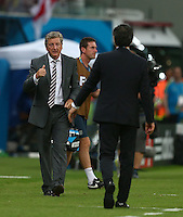 England manager Roy Hodgson gestures toward Italy coach Cesare Prandelli after his sides equalising goal, 1-1