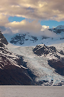 Cascade glacier flows out of the Chugach mountains in Prince William Sound, Alaska.
