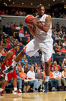 CHARLOTTESVILLE, VA- NOVEMBER 13:  Mike Scott #23 of the Virginia Cavaliers grabs a rebound during the game on November 13, 2011 at the John Paul Jones Arena in Charlottesville, Virginia. Virginia defeated South Carolina State 75-38. (Photo by Andrew Shurtleff/Getty Images) *** Local Caption *** Mike Scott