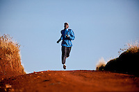 Elias Maindi, 28, winner of the 2008 Linz marathon, trains close to the Kenyan town of Iten. Athletes there are being hit by the economic crisis which is robbing races and runners of crucial sponsorship.