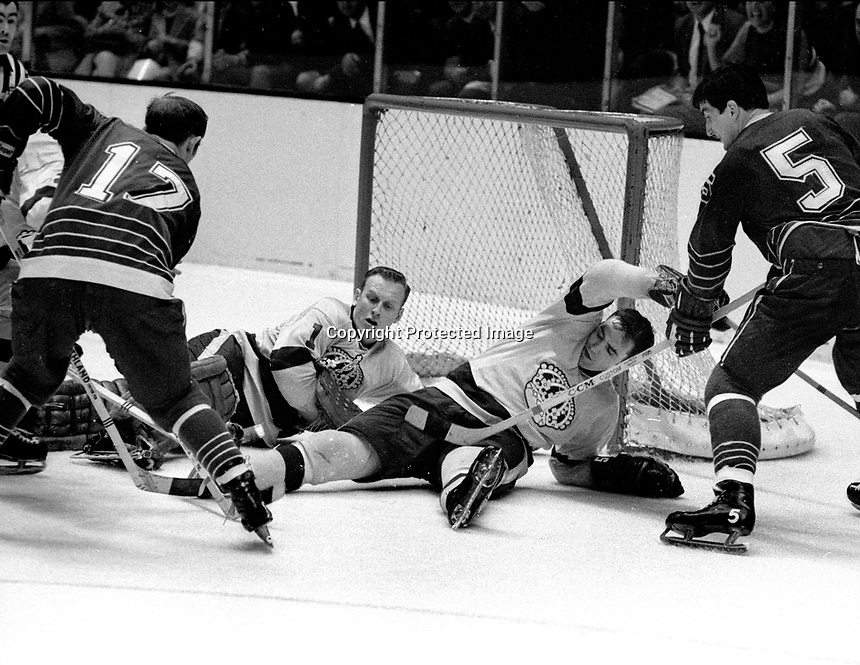 Seals vs. LA Kings:Seals Norm Ferguson and Carol Vadnais attack goalie Wayne Rutledge..(1969  photo by Ron Riesterer)