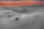 The San Francisco fog tops the Golden Gate Bridge of San Francisco, California.