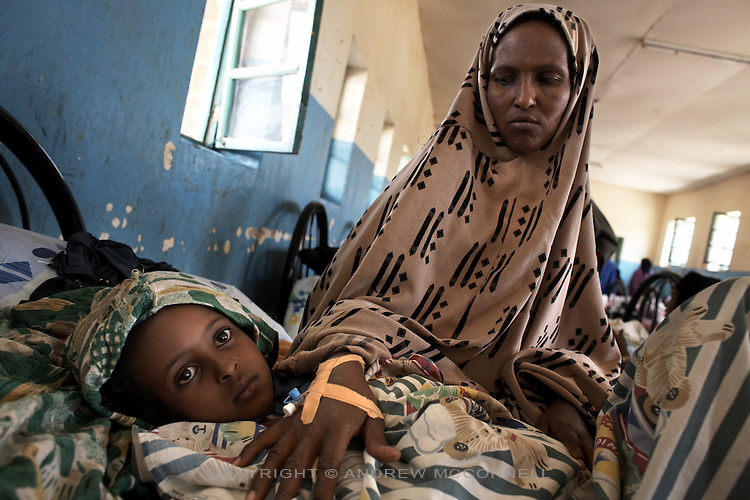 7 year-old Najah and her mother are treated for Cholera at Save the Children's Cholera Treatment Center in Burao, Somaliland, on Wednesday, July 25, 2007.
