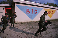 Fort Dix, NJ, USA, June 1980. US Army military training. Combat simulations. Coming out of the chemical rooms, where the soldiers are forced to pass with their masks through real combat gas.