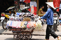 Hanoi<br /> , Vietnam - 2007 File Photo -<br /> <br /> <br /> A woman wearing a scarf to protect from pollution, push a cart full of sandals for sale, in Hanoi.<br /> <br /> <br /> photo : James Wong-  Images Distribution