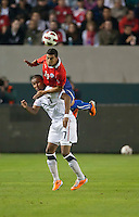 CARSON, CA – JANUARY 22: USA forward Juan Agudelo (17) and Chile defender Paulo Magalhaes (16) during the international friendly match between USA and Chile at the Home Depot Center, January 22, 2011 in Carson, California. Final score USA 1, Chile 1.
