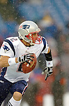 New England Patriotsbackup quarterback Doug Flutie scrambles for yardage against the Buffalo Bills at Ralph Wilson Stadium in Orchard Park, NY, on December 11, 2005 . The Patriots defeated the Bills 35-7. Mandatory Photo Credit: Ed Wolfstein
