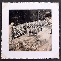 BNPS.co.uk (01202 558833)<br /> Pic: C&amp;TAuctions/BNPS<br /> <br /> Included in its pages is a candid shot of propoganda chief Goebbels laughing with crowds near the Berghof.<br /> <br /> A photo album containing never-before-seen candid snaps of Adolf Hitler that was found in Eva Braun's bedroom drawer in the Fuhrer's Bunker has sold for more than &pound;41,000.<br /> <br /> The remarkable images show the Nazi dictator and his henchmen in rare lighter moments of the Second World War.<br /> <br /> The album, which was unearthed after 72 years, sparked fervent interest and attracted a phone bid of more than double its estimate of &pound;18,000.<br /> <br /> The hammer price was &pound;34,000, with extra fees pushing the final total to &pound;41,140.<br /> <br /> There is one snap of a grinning Hitler in a 'Chaplinesque' pose and offering a playful salute to the person taking the photo outside his Berghof headquarters. Two more show him smiling in front of a crowd of children saluting him.