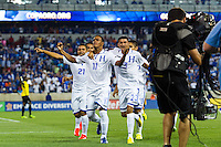 Honduras midfielder Rony Martinez (11) celebrates scoring with teammates during a CONCACAF Gold Cup group B match at Red Bull Arena in Harrison, NJ, on July 8, 2013.