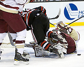 Tyler McNeely (Northeastern - 94), John Muse (BC - 1) - The Boston College Eagles defeated the Northeastern University Huskies 5-4 in their Hockey East Semi-Final on Friday, March 18, 2011, at TD Garden in Boston, Massachusetts.