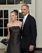 United States Attorney General Eric Holder and Dr. Sharon Malone arrive for the Official Dinner in honor of Prime Minister David Cameron of Great Britain and his wife, Samantha, at the White House in Washington, D.C. on Tuesday, March 14, 2012..Credit: Ron Sachs / CNP.(RESTRICTION: NO New York or New Jersey Newspapers or newspapers within a 75 mile radius of New York City)
