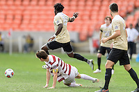 Houston, TX - Friday December 11, 2016: Ema Twumasi (22) of the Wake Forest Demon Deacons jumps over Drew Skundrich (12) of the Stanford Cardinal while going for the ball at the NCAA Men's Soccer Finals at BBVA Compass Stadium in Houston Texas.