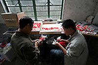 Workers in a plastic toy factory, Fengxiang, Shanghai, China
