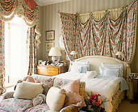 Matching fabric with a floral pattern has been used for all the soft furnishing in this bedroom