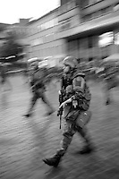 Soldiers in combat kit deploy in the centre of the Norwegian capital Oslo in the early hours of July 23 2011, following two attacks which have left more than 90 people dead. Police have arrested 32-year-old Anders Behring Breivik, a known right-wing extremist in connection with the incidents.
