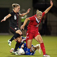 USWNT forward Amy Rodriguez in action against defender Lauren Sesselmann of Canada. USWNT played played a friendly against Canada at JELD-WEN Field in Portland, Oregon on September 22, 2011.
