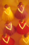 Traditional wedding ceremony with bridesmaids standing in line with others in the wedding party wearing colorful dresses.