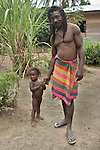 The Marowijne River, Suriname.  Rastafarian man and daughter in the village of Nason.