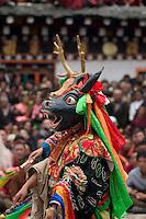 Yak dancer represents the animal world at the Monlam Chenpo, Katok Dorjeden Monastery - Kham, (Tibet), Sichuan, China
