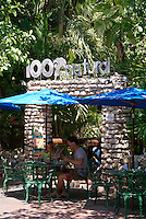 Tourist couple eating in an outdoor restaurant on Fifth Avenue or Quinta Avenida in Playa del Carmen, Riviera Maya, Quintana Roo, Mexico...