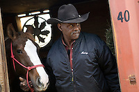 2 December 2006 - New York City, NY - Edward J. Dixon, President of the Federation of Black Cowboys, looks out of a stall at the Cedar Lanes stables in the borough of Queens in New York City, USA, 2 December 2006. The Federation gathers black men and women who recreate the heritage of black cowboys, teach kids to ride and put on 'rodeo showdeos'.