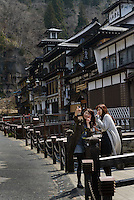 Visitors on the main street. Ginzan Onsen, Yamagata Prefecture, Japan, April 12, 2016. Once a sliver-mining town, Ginzan Onsen in Yamagata Prefecture is now one of Japan's best-known and most picturesque hot spring resorts. Its Taisho-period architecture and retro atmosphere is said to have been an inspiration for Hayao Miyazaki's Oscar-winning animated film, Spirited Away.