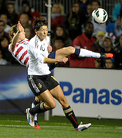 US defender Kelley O'Hara (5) clears the ball in front of Germany's Linda Bresonik (10).  The U.S. Women's National Team tied Germany 1-1 in a friendly at Toyota Park in Bridgeview, IL on October 20, 2012.