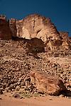 Reddish sand and stone in the Wadi Rum