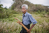 A typical Sumbanese man with his machete in the village of Wainyapu, Kodi.