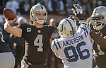 Oakland Raiders quarterback Derek Carr (4) passes ball under pressure from Indianapolis Colts defensive end Henry Anderson (96) on Saturday, December 24, 2016, at O.co Coliseum in Oakland, California.  The Raiders defeated the Colts 33-25.