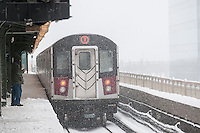 An elevated Flushing Line train departs the Queensboro Plaza station in New York during Winter Storm Jonas on Saturday, January 23, 2016. Due to blizzard conditions approaching the MTA announced they will be suspending all above ground subway service as of 4:00 PM. (© Richard B. Levine)