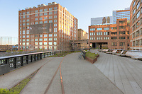 A view of High Line Park, including old railroad tracks left in place, and the surrounding area.  The High Line is an urban aerial greenway reclaimed from the abandoned elevated West Side Line in New York City's Meatpacking district.