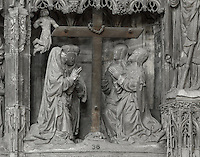 St John the Baptist, Mary Magdalene, the Virgin Mary and an unidentified woman kneel before the cross in worship, while an angel flies behind. The Adoration of the Cross, before 1540, from the choir screen, Chartres Cathedral, Eure-et-Loir, France. Chartres cathedral was built 1194-1250 and is a fine example of Gothic architecture. It was declared a UNESCO World Heritage Site in 1979. Picture by Manuel Cohen.