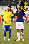 Colombian player Mario Yepes (3) regrets with Brazilian player Neymar after missing a penalty shoot during their friendly match at MetLife Stadium in East Rutherford New Jersey, November 14, 2012. Photo by Eduardo Munoz Alvarez / VIEWpress.