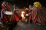 Women gathered around a fire, Gujarat, India