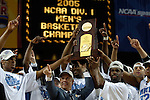 4 APR 2005: Members of the North Carolina Tar Heels, along with head coach Roy Williams, hold up their championship trophy following the Men's Final Four Championship game held at the Edward Jones Dome in St. Louis, MO. The North Carolina Tar Heels went on to defeat the University of Illinois Fighting Illini 75-70 to claim the championship title. Ryan McKee/NCAA Photos