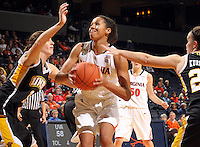 Dec. 18, 2010; Charlottesville, VA, USA; Virginia Cavaliers center Simone Egwu (4) tries to shoot between UMBC Retrievers Meghan Colabella forward (10) and UMBC Retrievers guard Michelle Kurowski (20) during the game at the John Paul Jones Arena. Virginia won 61-46. Mandatory Credit: Andrew Shurtleff