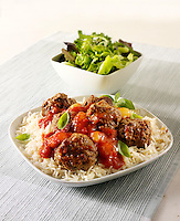 Meat balls with a ragu sauce on rice