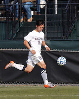 University of Connecticut defender Flo Liu (16) dribbles down the wing..NCAA Tournament. Creighton University (blue) defeated University of Connecticut (white), 1-0, at Morrone Stadium at University of Connecticut on December 2, 2012.