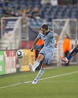 Sporting Kansas City midfielder Davy Arnaud (22) passes the ball. In a Major League Soccer (MLS) match, the New England Revolution defeated Sporting Kansas City, 3-2, at Gillette Stadium on April 23, 2011.
