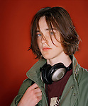 Male teen (18 years old)  with headphones, portrait.