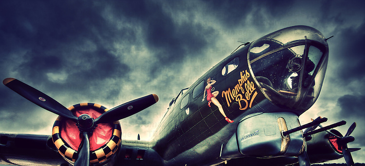 World War II bomber plane named Memphis Belle under storm skies. Memphis Belle is the nickname of a Boeing B-17F Flying Fortress during the Second World War