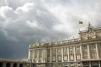 Spain. Province of Madrid. Madrid. The Palacio Real de Madrid (Royal Palace of Madrid), also called Palacio de Oriente (Palace of Orient) is the official residence of the King of Spain. It is still used for state occasions. The palace is owned by the Spanish state and administered by the Patrimonio Nacional agency. The palace is located on Bailén street, in the western part of downtown Madrid. The palace is the largest in Western Europe, occupying an area of 135,000 square meters. The wheather is thundery. Black clouds. Spanish flag.© 2007  Didier Ruef