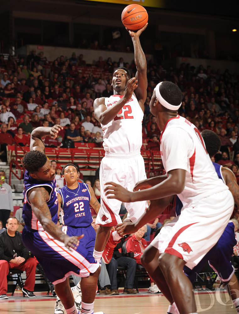 NWA Media/ANDY SHUPE - Arkansas' Jacorey Williams (22) takes a shot in the lane against Northwestern State during the second half of the Razorbacks' 100-92 win Sunday, Dec. 28, 2014, in Bud Walton Arena in Fayetteville.