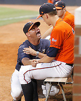 Virginia pitching coach Karl Kuhn talks with pitcher Cody Winiarski before his debut in game six of the 2011 NCAA regionals last weekend. Photo/Andrew Shurtleff