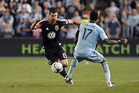 Chris Pontius (13) midfield D.C Utd goes past C.J Sapong..Sporting Kansas City defeated D.C Utd 1-0 at Sporting Park, Kansas City, Kansas.